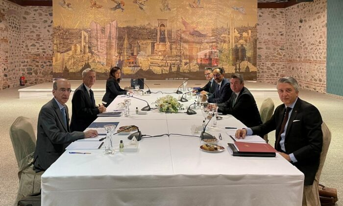 Representatives of Turkey and Greece attend a meeting as part of the bilateral talks on the maritime disputes in Istanbul, Turkey, on Jan. 25, 2021. (Turkish Foreign Ministry/Handout via Reuters)