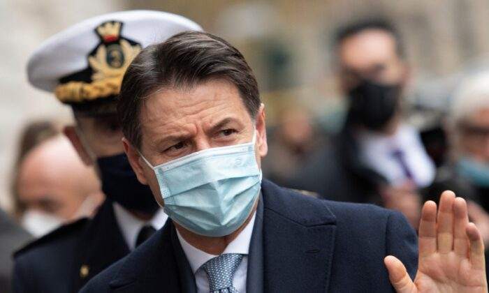 Italy's Prime Minister Giuseppe Conte waves as he arrives to take part in a ceremony to replace the Commander General of the Carabinieri Corps at the 'De Tommaso' barracks in Rome, on Jan. 15, 2021. (Alberto Pizzoli/AFP via Getty Images)