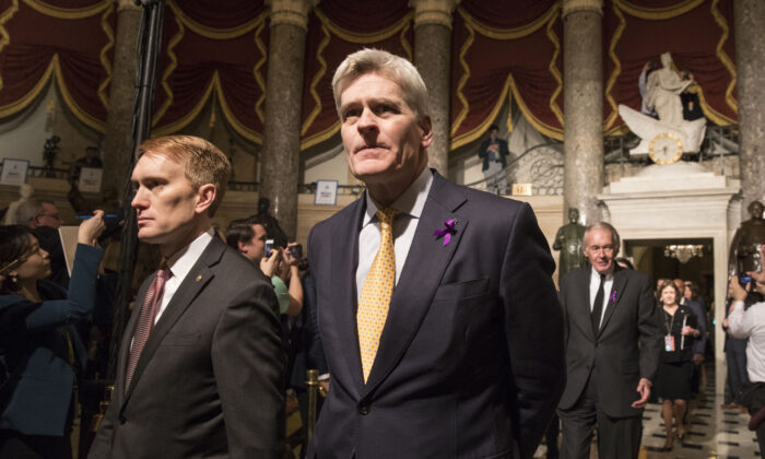 Sen. Bill Cassidy (R-La.), center, walks in the Statuary Hall of the Capitol building on the way to attending the State of the Union in Washington on Jan. 30, 2018. (Samira Bouaou/The Epoch Times)