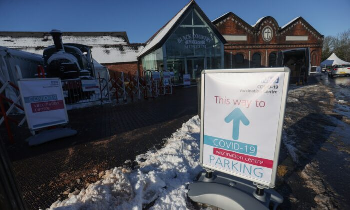 A sign indicates the direction for the parking of the COVID-19 vaccine newly opened centre at the Black Country Living Museum, in Dudley, Birmingham, Britain, on Jan. 25, 2021. (Carl Recine/Reuters)