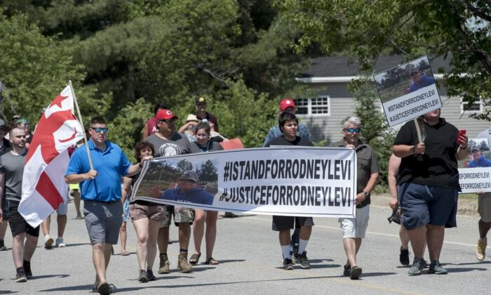People walk to honour Rodney Levi in Red Bank, N.B., on June 19, 2020. New Brunswick's Public Prosecutions Service has concluded no charges will be filed against police officers involved in the fatal shooting of Rodney Levi last year. (Stephen MacGillivray/The Canadian Press)