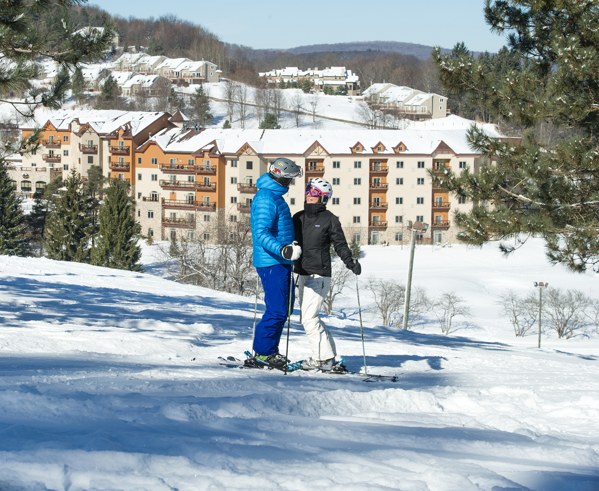 Couple-Overlooking-Tamarack-Club-at-Holiday-Valley
