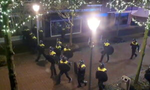 Dutch Police Detain More Than 180 in Third Night of Curfew Violence