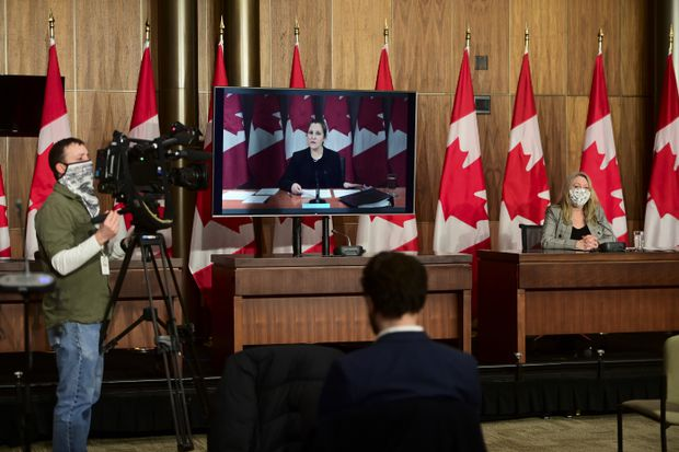 Minister of Middle Class Prosperity and Associate Minister of Finance Mona Fortier holds a press conference as she is joined virtually by Minister of Finance Chrystia Freeland in Ottawa on Jan. 25, 2021. (Sean Kilpatrick/The Canadian Press)