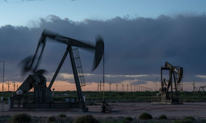 Pump jacks operate at dusk near Loco Hills in Eddy County, N.M., on April 23, 2020. (Paul Ratje/AFP via Getty Images)