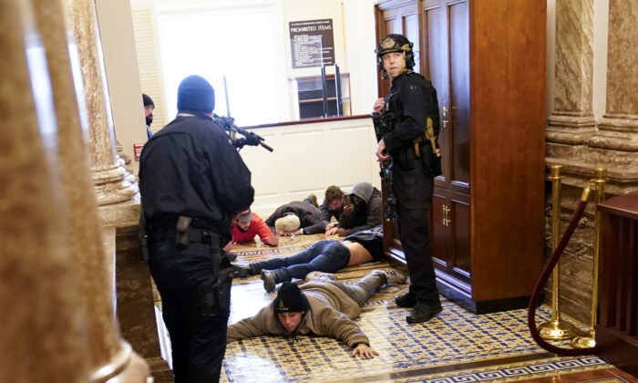 U.S. Capitol Police hold rioters at gun-point near the House Chamber inside the U.S. Capitol in Washington on Jan. 6, 2021. (Andrew Harnik/AP Photo)