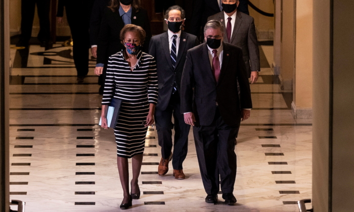 House Clerk Cheryl Johnson, Rep. Jamie Raskin (D-Md.), and Rep. David Cicilline (D-R.I.) walk through the Capitol's Statuary Hall to deliver the article of impeachment for incitement of insurrection against former President Donald Trump to the Senate floor in Washington on Jan. 25, 2021. (Tasos Katopodis/Pool/via Reuters)