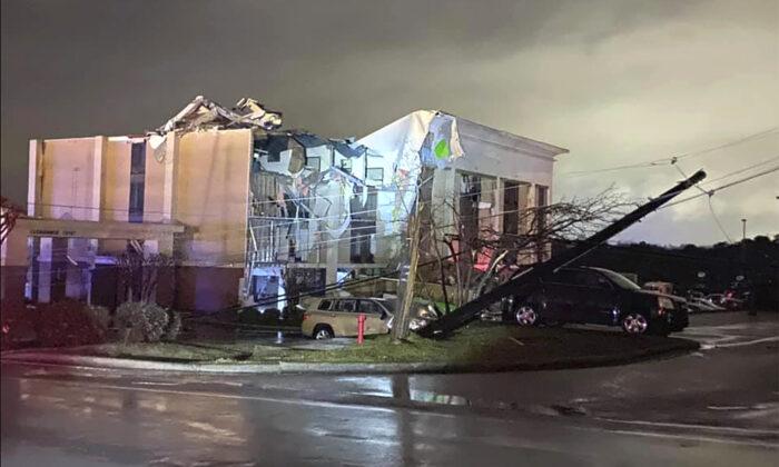 A Hampton Inn hotel is severely damaged after a tornado tore through Fultondale, Ala., on Jan. 25, 2021. (Alicia Elliott via AP)