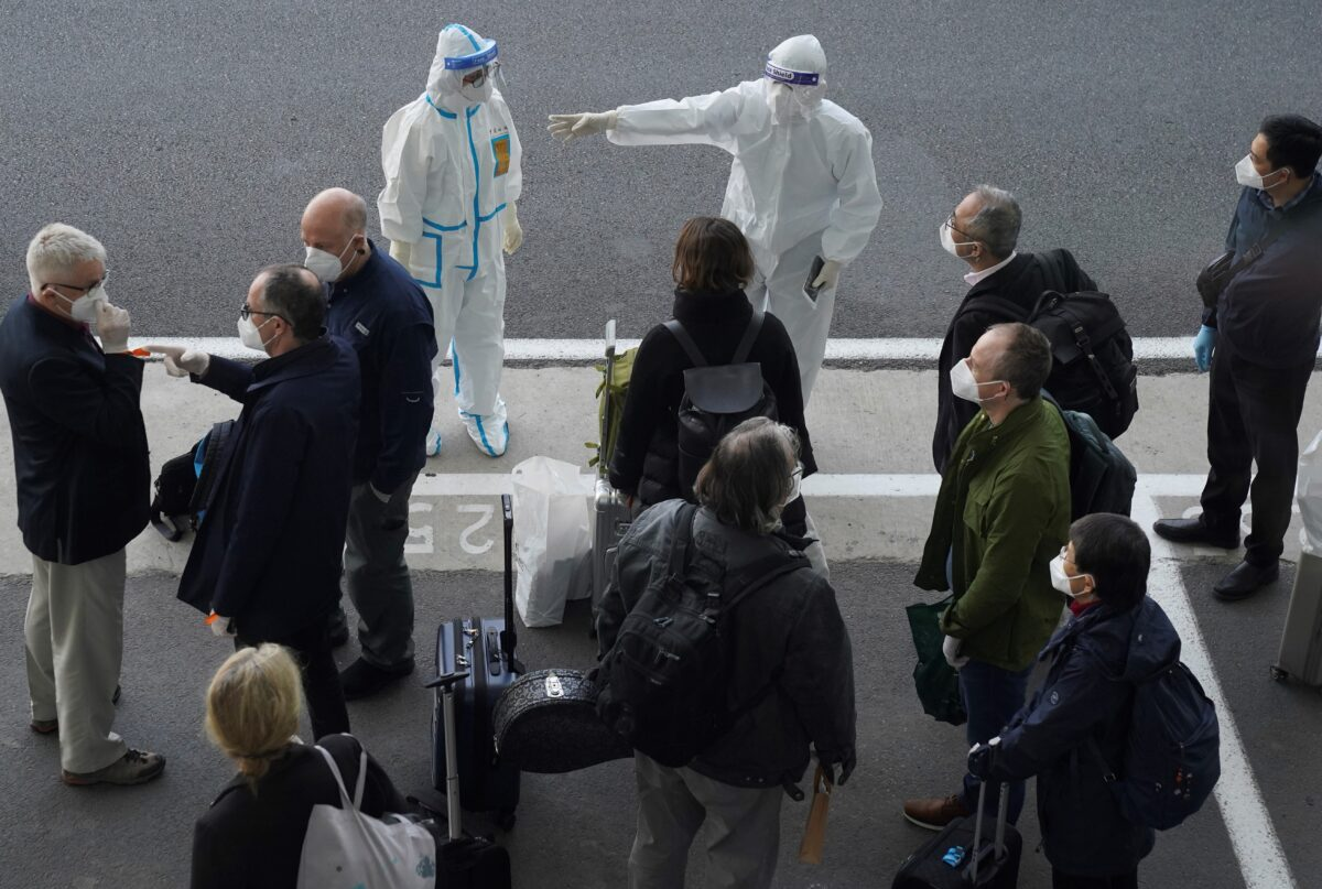 Virus Outbreak members of the World Health Organization (WHO) team on their arrival at the airport in Wuhan in central China's Hubei province.