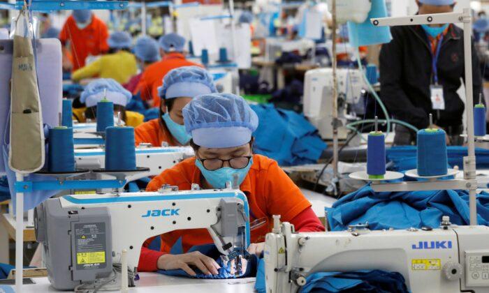 Labourers work at Hung Viet garment export factory in Hung Yen province, Vietnam, on Dec. 30, 2020. (Kham/Reuters)