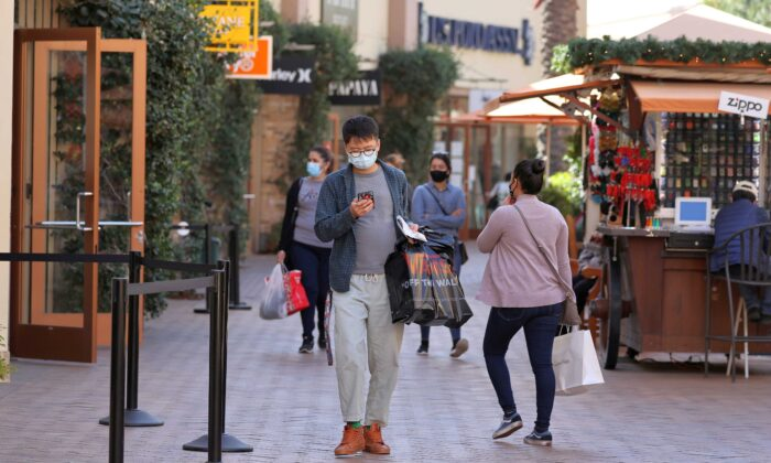 People shop at the Citadel Outlet mall in Commerce, Calif., on Dec. 3, 2020. (Lucy Nicholson/Reuters)