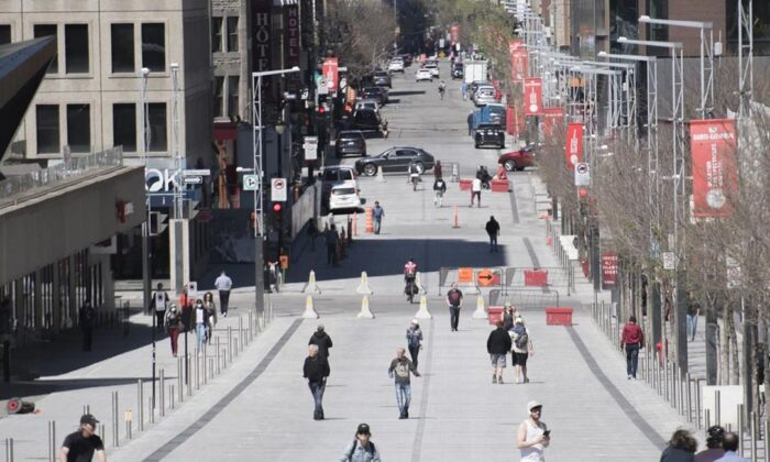 People walk along a pedestrianized zone of Sainte-Catherine street in Montreal, on May 18, 2020, as the COVID-19 pandemic continues in Canada and around the world. Newly released statistics point to a major drop in police-recorded crime during the first eight months of the COVID-19 pandemic. (Graham Hughes/The Canadian Press)