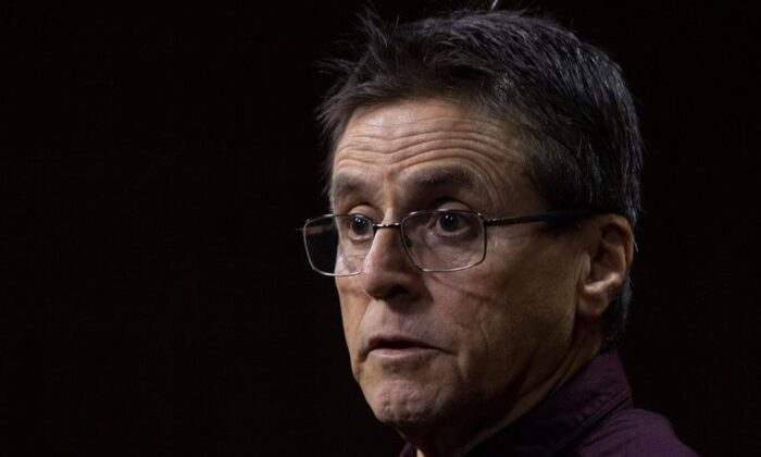 Hassan Diab holds a news conference on Parliament Hill, in Ottawa on February 7, 2020. A lawyer for Diab says a French appeal court's order that the Ottawa sociology professor stand trial for a decades-old synagogue bombing is the latest misstep in a long odyssey of injustice. (Fred Chartrand/The Canadian Press)