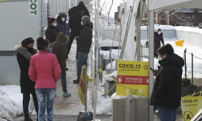 People line up at a COVID-19 testing clinic, on January 19, 2021 in Montreal. (Ryan Remiorz/The Canadian Press)