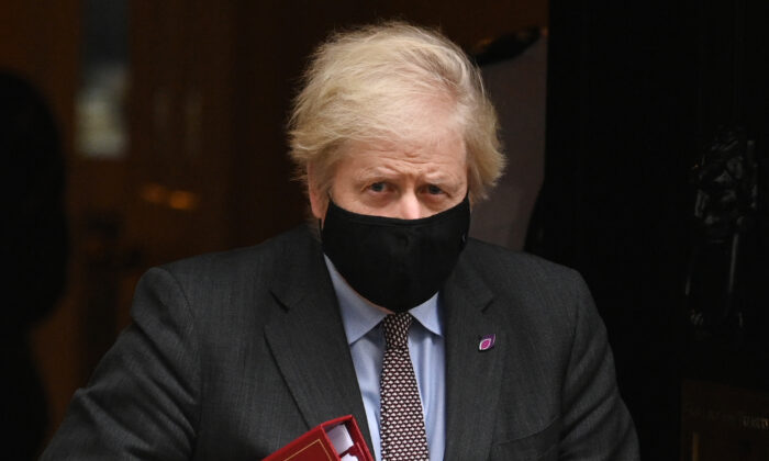 Prime Minister Boris Johnson leaves Downing Street for Prime Minister's Questions in Parliament on Jan. 27, 2021. (Leon Neal/Getty Images)