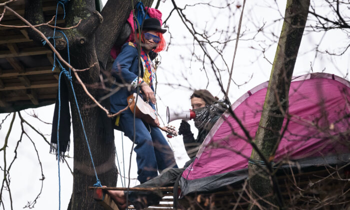 "Protesters remain in their treetop positions as bailiffs and police officers attempt to clear the site of a ""Stop HS2"" camp at Euston Station in London on Jan. 27, 2021. (Leon Neal/Getty Images)"