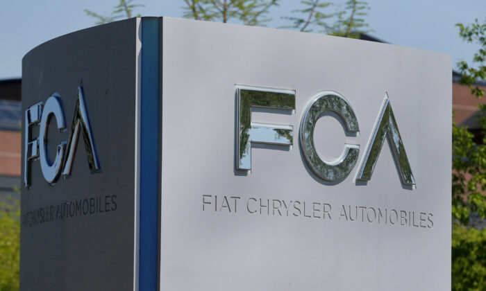 A Fiat Chrysler Automobiles (FCA) sign is at the U.S. headquarters in Auburn Hills, Mich., on May 25, 2018. (Rebecca Cook/Reuters)