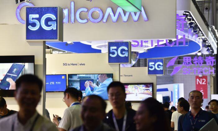 Logos of 5G providers at the Shanghai New International Expo Centre in Shanghai on June 27, 2019. (Hector Retamal/AFP via Getty Images)