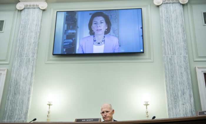 Sen. Rick Scott (R-Fla.) questions Gina Raimondo, nominee for secretary of commerce, during her Senate Commerce, Science, and Transportation Committee confirmation hearing in Washington on Jan. 26, 2021. (Tom Williams/CQ Roll Call/POOL)