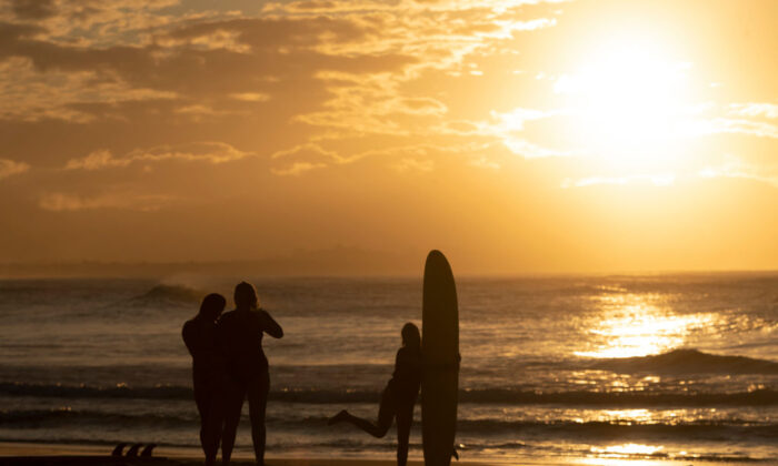People take a photo during sunset on June 11, 2020 in Byron Bay, Australia. (Brook Mitchell/Getty Images)