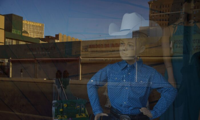 A young cowboy mannequin peers through a window in El Paso, Texas, on Oct. 23, 2020. (Paul Ratje/AFP via Getty Images)