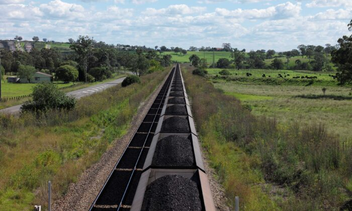 An Aurizon coal train travels through the countryside in Muswellbrook, north of Sydney, Australia, on April 9, 2017. (Jason Reed/Reuters)