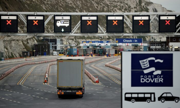 A truck drives toward the entrance to the Port of Dover, following the end of the Brexit transition period, in Dover, England, on Jan. 15, 2021. (John Sibley/Reuters)