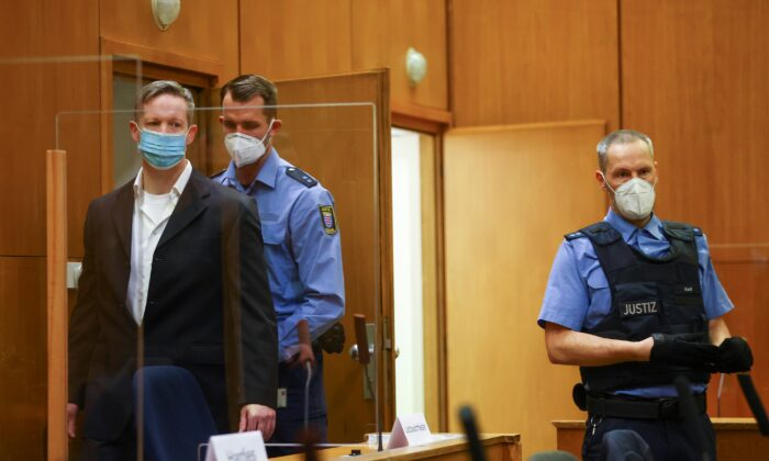 Main defendant Stephan Ernst arrives at the courtroom as he waits for the verdict in the case of the murder of Walter Luebcke, at the Higher Regional Court in Frankfurt, Germany, on Jan. 28, 2021. (Kai Pfaffenbach/Pool/Reuters)