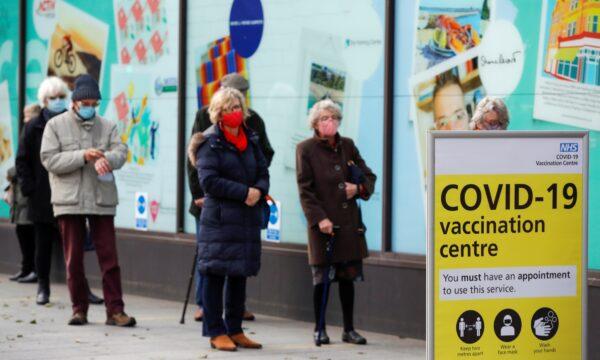 People queue to receive the coronavirus disease (COVID-19) vaccine