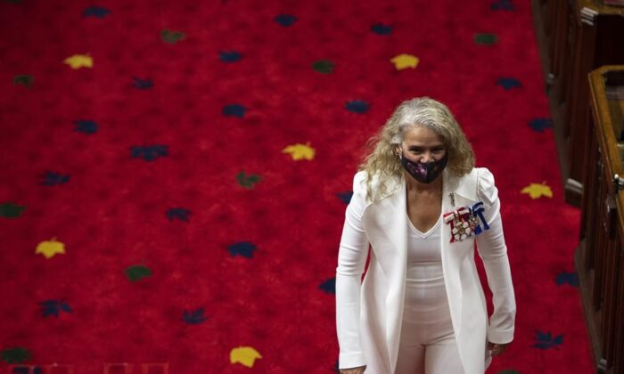 Gov.Gen Julie Payette walks in the chamber after greeting Senators before delivering the Speech from the Throne, at the Senate of Canada Building in Ottawa, on Sept. 23, 2020. (Justin Tang/The Canadian Press)