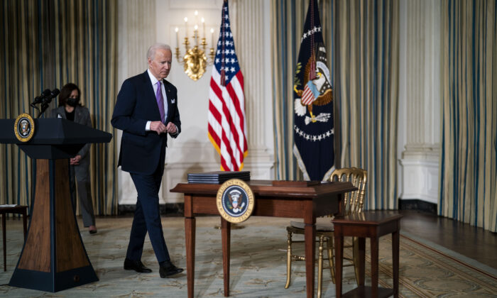 President Joe Biden prepares to sign executives orders related to his racial equity agenda at the White House on Jan. 26, 2021. (Doug Mills-Pool/Getty Images)