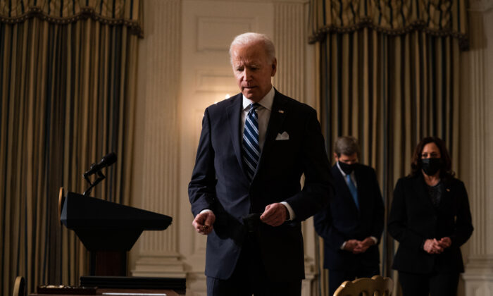 U.S. President Joe Biden prepares to sign executive orders after speaking about climate change issues in the State Dining Room of the White House in Washington on Jan. 27, 2021. Biden signed several executive orders related to the climate change crisis on Wednesday, including one directing a pause on new oil and natural gas leases on public lands. (Anna Moneymaker-Pool/Getty Images)