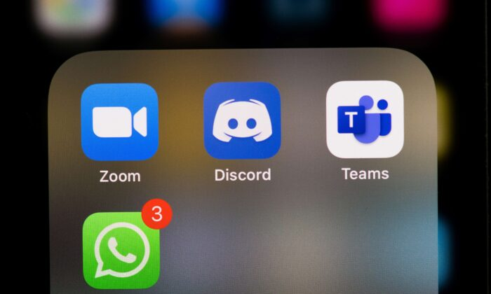 This illustration picture taken on May 27, 2020 in Paris shows the logos of the social networks  applications Zoom, Discord, Teams and WhatsApp on the screen of a phone. (MARTIN BUREAU/AFP via Getty Images)