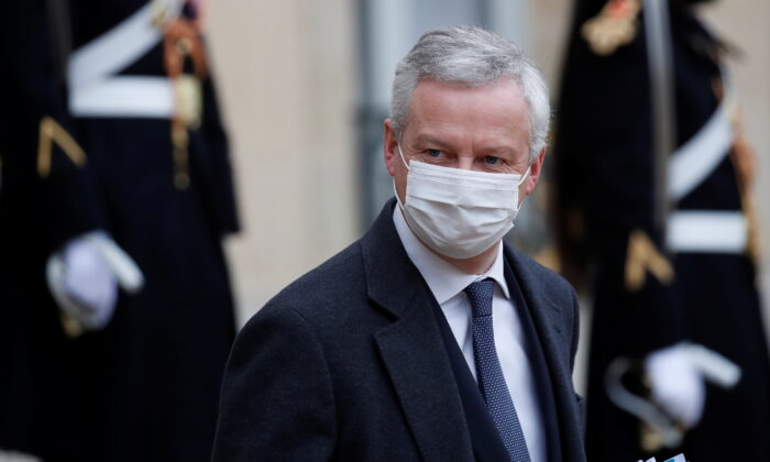 French Economy and Finance Minister Bruno Le Maire, wearing a protective face mask, leaves following the weekly cabinet meeting at the Elysee Palace in Paris, France on Jan. 27, 2021. (Gonzalo Fuentes/Reuters)