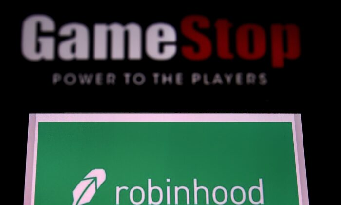 The logos of video game retail store GameStop and trading app Robinhood are displayed on a computer and a mobile phone in Arlington, Va., on Jan. 28, 2021. (Olivier Douliery/AFP via Getty Images)