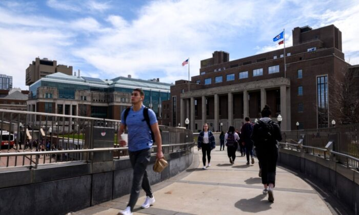 Students walk on the University of Minnesota campus  in Minneapolis on April 9, 2019. The university closed its Confucius Institute in 2019. (Stephen Maturen/Getty Images)