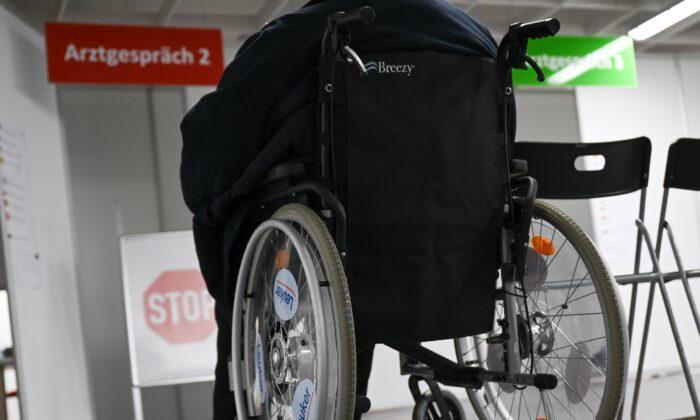 A woman in a wheelchair in Heuchelheim, Germany, on Jan. 21, 2021. (Arne Dedert/Pool/AFP via Getty Images)