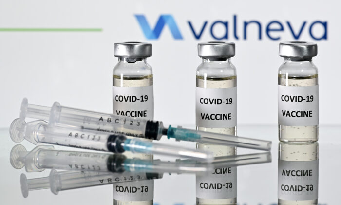 An illustration picture shows vials with COVID-19 vaccine stickers attached and syringes with the logo of French-Austrian vaccine firm Valneva on Nov. 17, 2020. (Justin Tallis/AFP via Getty Images)