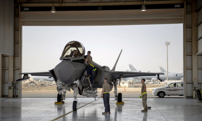 An F-35 fighter jet pilot and crew prepare for a mission at Al-Dhafra Air Base in the United Arab Emirates, on Aug. 5, 2019. (Staff Sgt. Chris Thornbury/U.S. Air Force via AP)