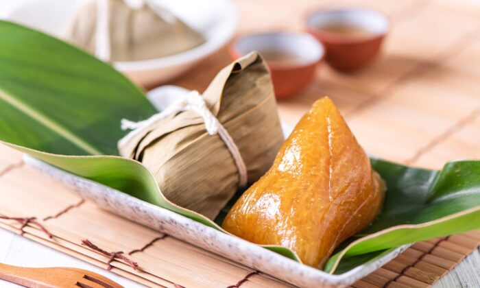 Chinese sticky rice dumplings, or zongzi, often include twice-cooked ingredients and are an example of a warming food. (Romix Image/Shutterstock)