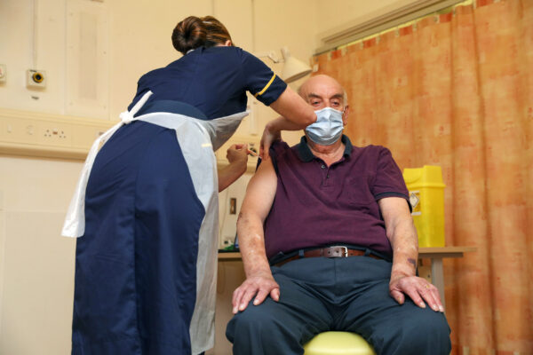 82-year-old Brian Pinker receives the Oxford University/AstraZeneca COVID-19 vaccine
