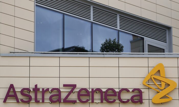 A general view of AstraZeneca offices and the corporate logo in Cambridge, England, on July 18, 2020. (Alastair Grant/AP Photo)