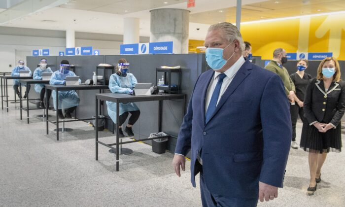 Ontario Premier Doug Ford walks through the COVID-19 testing centre in the International Arrivals section at Pearson Airport in Toronto on Jan. 26, 2021. (Frank Gunn/The Canadian Press)
