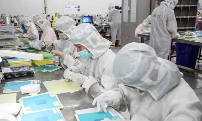 Workers producing LED chips at a factory in Huaian city, in China's eastern Jiangsu Province, on June 16, 2020. (STR/AFP via Getty Images)
