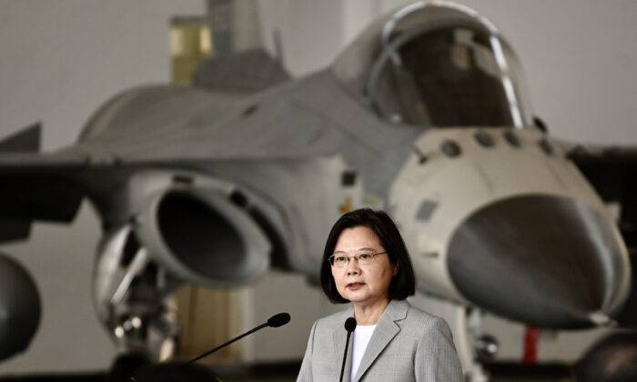 Taiwan's President Tsai Ing-wen speaks in front of a domestically-manufactured F-CK-1 indigenous defense fighter jet during her visit to Penghu Air Force Base, Taiwan, on Sept. 20, 2020. (Sam Yeh/AFP via Getty Images)