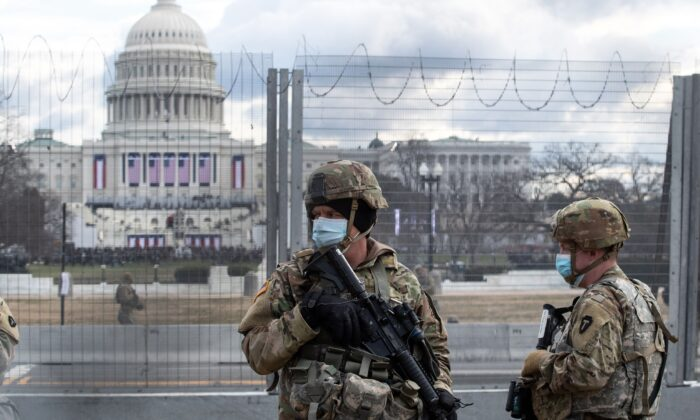 National Guard troops patrol the vicinity of the Capitol hours before the inauguration of President Joe Biden in Washington on Jan. 20, 2021. (Roberto Schmidt/AFP via Getty Images)