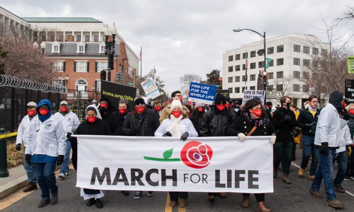 "Pro-life activists participate in the ""March for Life,"" an annual event to mark the anniversary of the 1973 Supreme Court case Roe v. Wade, which legalized abortion in the US, outside the US Supreme Court in  Washington on Jan. 29, 2021. (Saul Loeb/AFP via Getty Images)"