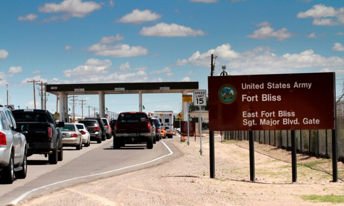 Cars wait to enter Fort Bliss in El Paso, Texas, on Sept. 9, 2014. (Juan Carlos Llorca/AP Photo)