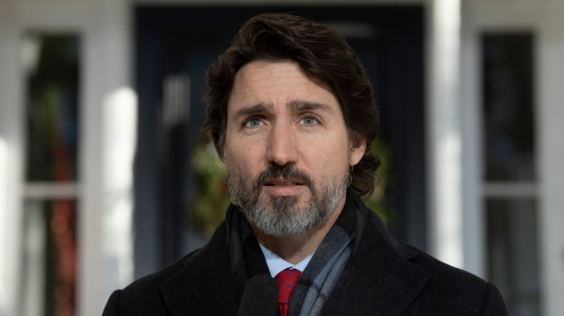 Prime Minister Justin Trudeau during a news conference outside Rideau Cottage in Ottawa on Dec. 18, 2020. (The Canadian Press/Adrian Wyld)