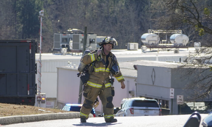 A Hall County firefighter leaves following a liquid nitrogen leak that killed six people at Prime Pak Foods, a poultry plant in Gainesville, Ga., on Thursday, Jan. 28, 2021. (John Bazemore/AP Photo)